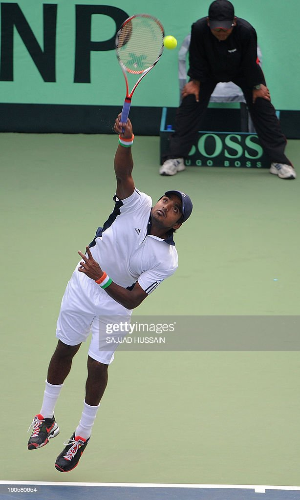 Indian tennis player Virali-Murugesan Ranjeet gestures as he plays against South Korean opponent Jeong Suk-Young during the reverse singles match of the Davis Cup at the Delhi Lawn Tennis Association (DLTA) courts in New Delhi on February 3, 2013. South Korea won the game 6-4, 6-4, 6-2.