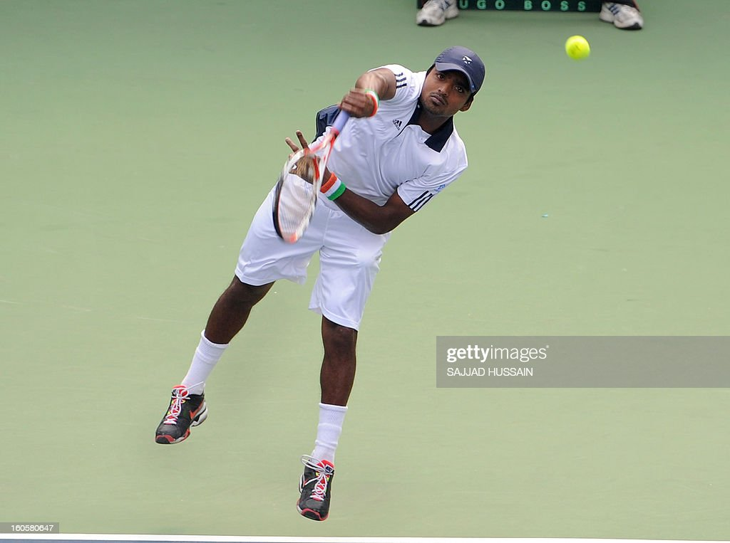 Indian tennis player Virali-Murugesan Ranjeet serves against South Korean opponent Jeong Suk-Young during the reverse singles match of the Davis Cup at the Delhi Lawn Tennis Association (DLTA) courts in New Delhi on February 3, 2013. South Korea gestures as he playswon the game 6-4, 6-4, 6-2.