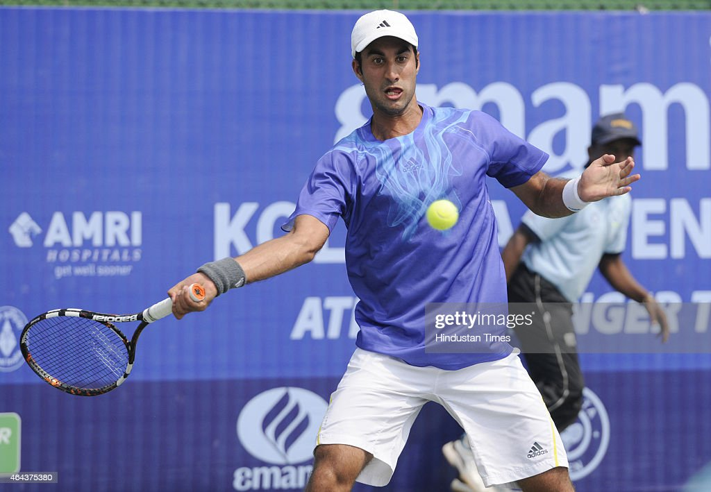 Indian tennis player <a gi-track='captionPersonalityLinkClicked' href=/galleries/search?phrase=Yuki+Bhambri&family=editorial&specificpeople=4835849 ng-click='$event.stopPropagation()'>Yuki Bhambri</a> in action against Maldovian player Radu Albot during Pre-quarterfinals match of ATP Kolkata Open 2015 match on February 25, 2015 in Kolkata, India.