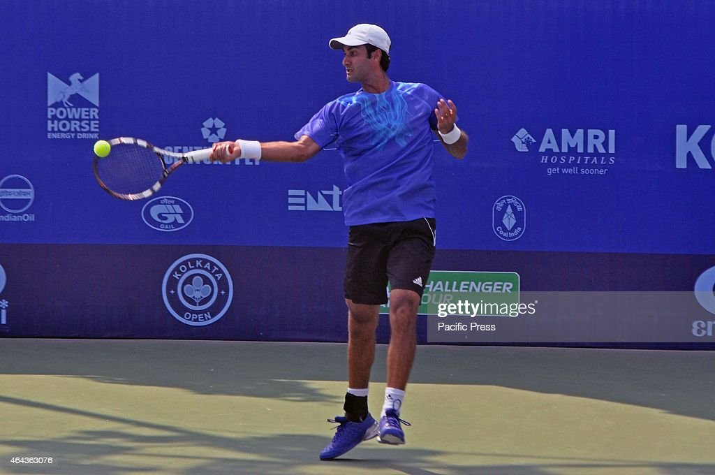 Indian tennis player, <a gi-track='captionPersonalityLinkClicked' href=/galleries/search?phrase=Yuki+Bhambri&family=editorial&specificpeople=4835849 ng-click='$event.stopPropagation()'>Yuki Bhambri</a> in action against Spanish Tennis Player Enrique Lopez-Perez during the Emami Kolkata Open 2015 - ATP Challenger Tour.