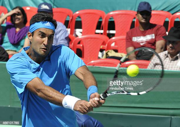 Indian tennis player Yuki Bhambri in action against Tsung Hua Yang of Chinese Taipei during the second singles match of Davis Cup Asia/Oceania Group...