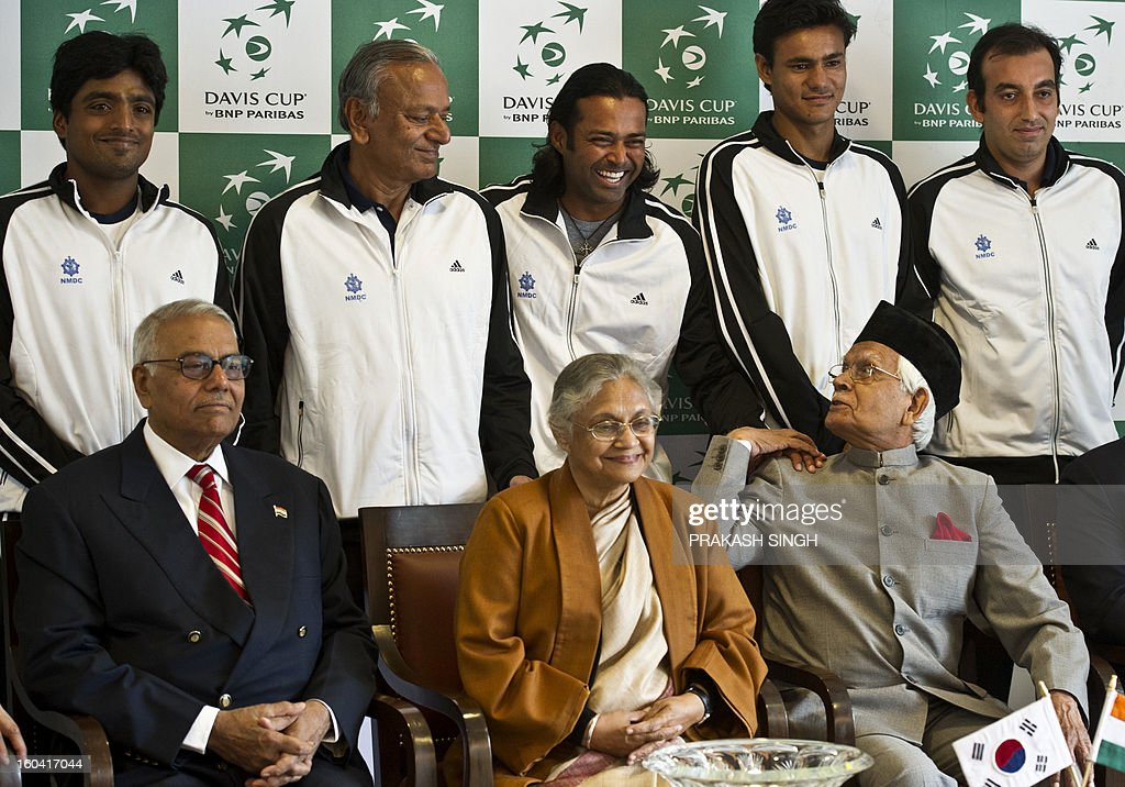 Indian tennis players Ranjeet Virali Murugesan (back-L), Leander Paes (back-C), Vijayant Malik (back-2R) and Purav Raja (R) pose with Delhi Chief Minister Shiela Dikshit (front-C) and former All India Tennis Association (AITA) President Yashwant Sinha (front-L) after the draw at the Delhi Lawn Tennis Association (DLTA) tennis court in New Delhi on January 31, 2013. India will host South Korea in a Davis Cup Asia/Oceania Group I first round tie match, from February 1-3, 2013. AFP PHOTO/ Prakash SINGH