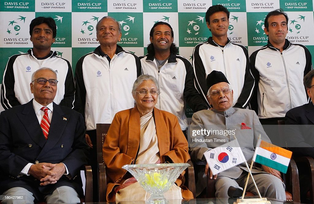 Indian tennis players Ranjeet Virali Murugesan (back-L), Leander Paes (back-C), Vijayant Malik (back-2R) and Purav Raja (R) pose with Delhi Chief Minister Shiela Dikshit (front-C) and former All India Tennis Association (AITA) President Yashwant Sinha (front-L) after the draw at the Delhi Lawn Tennis Association (DLTA) tennis court on January 31, 2013 in New Delhi, India. India will host South Korea in a Davis Cup Asia/Oceania Group I first round tie match, from February 1-3, 2013.