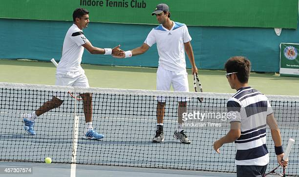 Indian tennis players Yuki Bhambri and Divij Sharan exult after beating Hiroki Moriya and Yasutaka Uchiyama of Japan 76 62 at the doubles event...