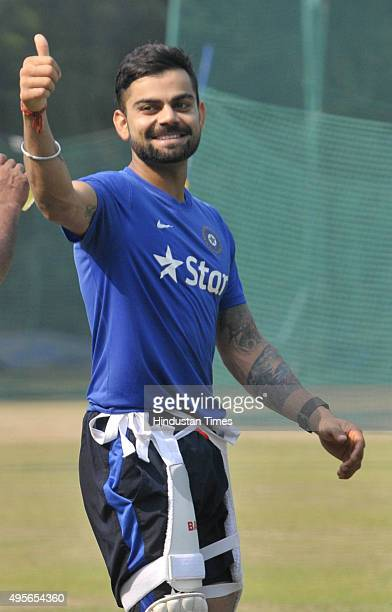 Indian Test team skipper Virat Kohli waves towards fans during the net practice before India's scheduled match against South Africa cricket team at...