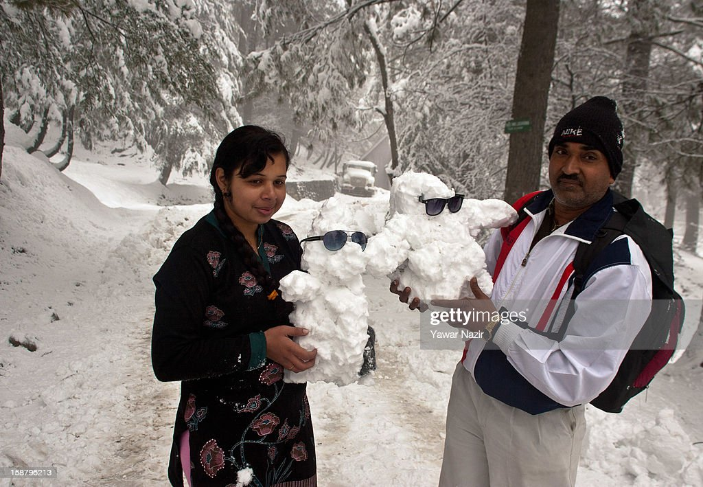 Indian tourists carry little snowmen during a snowfall on December 29, 2012 in Gulmarg, 54 km (35 miles) to the west of Srinagar, the summer capital of Indian-administered Kashmir, India. With the second round of heavy snowfall in Kashmir valley, skiers from around the globe have descended on the ski resort of Gulmarg, known for long-run skiing, snow-boarding, heli-skiing and steep mountains. Gulmarg is located less than six miles from the ceasefire line or Line of Control (LoC) that divides Kashmir between India and Pakistan. As a sense of normalcy has started to return to this strife-torn region, various foreign governments, including the United Kingdom, have lifted the travel advisory to its citizens traveling to Kashmir, raising the hopes of the local tourism industry, officials said.