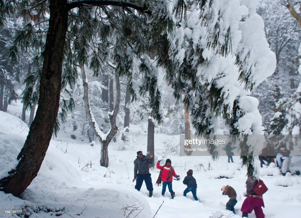 Indian tourists play with snow during a snowfall on December 29, 2012 in Gulmarg, 54 km (35 miles) to the west of Srinagar, the summer capital of Indian-administered Kashmir, India. With the second round of heavy snowfall in Kashmir valley, skiers from around the globe have descended on the ski resort of Gulmarg, known for long-run skiing, snow-boarding, heli-skiing and steep mountains. Gulmarg is located less than six miles from the ceasefire line or Line of Control (LoC) that divides Kashmir between India and Pakistan. As a sense of normalcy has started to return to this strife-torn region, various foreign governments, including the United Kingdom, have lifted the travel advisory to its citizens traveling to Kashmir, raising the hopes of the local tourism industry, officials said.