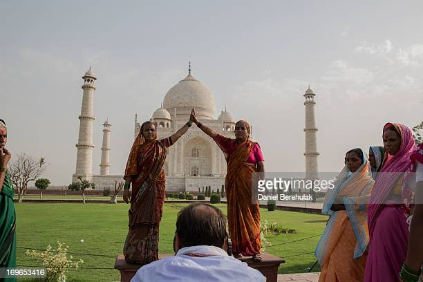Indian tourists pose for a photograph as they visit the Taj Mahal on May 30 2013 in Agra India Completed in 1643 the mausoleum was built by the...