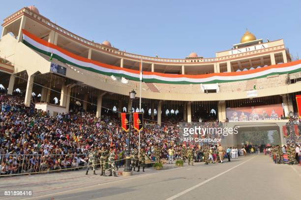 Indian tourists sit in a newly constructed gallery during the daily beating of the retreat ceremony at the IndiaPakistan Wagah Border Post some 35kms...