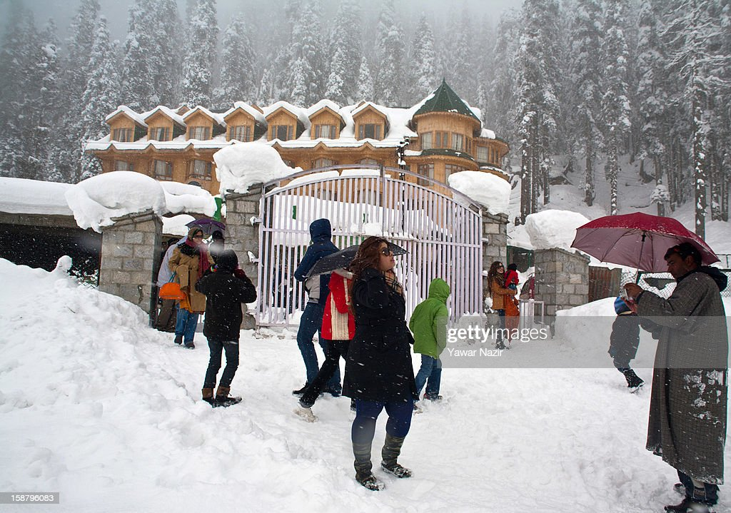 Indian tourists take pictures after a snowfall on December 29, 2012 in Gulmarg, 54 km (35 miles) to the west of Srinagar, the summer capital of Indian-administered Kashmir, India. With the second round of heavy snowfall in Kashmir valley, skiers from around the globe have descended on the ski resort of Gulmarg, known for long-run skiing, snow-boarding, heli-skiing and steep mountains. Gulmarg is located less than six miles from the ceasefire line or Line of Control (LoC) that divides Kashmir between India and Pakistan. As a sense of normalcy has started to return to this strife-torn region, various foreign governments, including the United Kingdom, have lifted the travel advisory to its citizens traveling to Kashmir, raising the hopes of the local tourism industry, officials said.