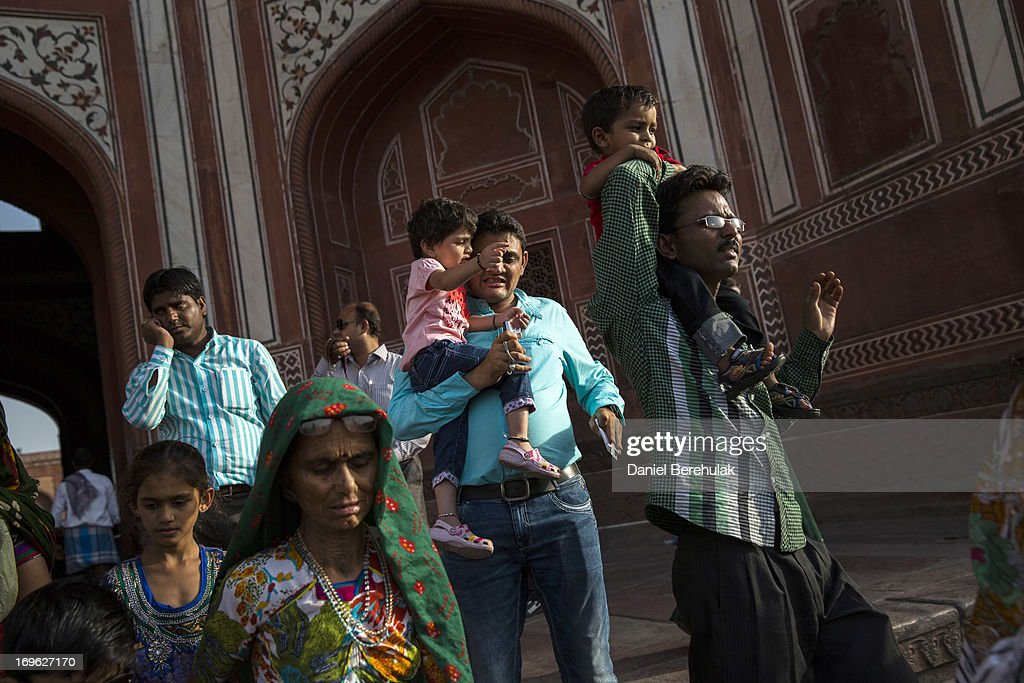 Indian tourists visit the Taj Mahal on May 29, 2013 in Agra, India. Completed in 1643, the mausoleum was built by the Mughal emperor Shah Jahan in memory of his third wife, Mumtaz Mahal, who is buried there alongside Jahan.