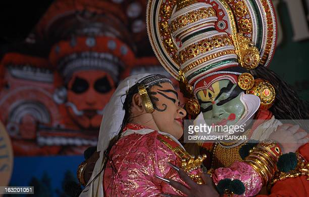 Indian traditional dancers from the southern Indian state of Kerala perform in Kolkata on March 6 2013 The tourism department of Kerala organised a...