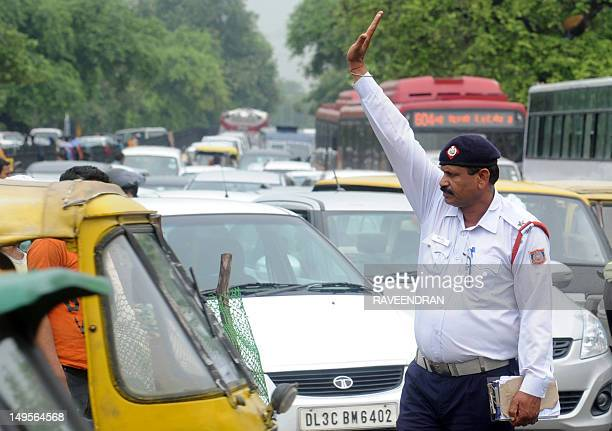 Indian traffic police direct traffic at an intersection during a power outage in New Delhi on July 31 2012 A massive power failure hit India for the...