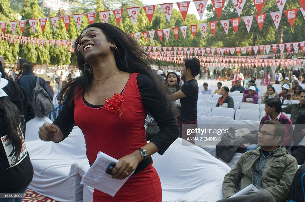 Indian transgender activist Abhina Aher dances as she participants in a cultural event following the All-India Run as they observe World Aids Day in New Delhi on December 2, 2012. More than 1,000 people joined together to raise awareness of the continued support needed to address HIV among high-risk groups and to celebrate the diversity of affected communities. AFP PHOTO/ Anna ZIEMINSKI