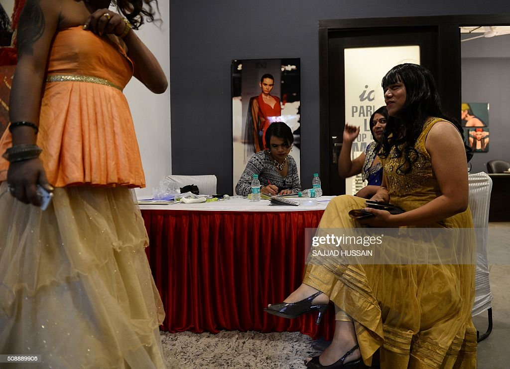 Indian transgender models register at a counter before auditions in New Delhi on February 7, 2016. A non-profit group conducted the first of its kind modelling auditions for transgenders,who often live on the extreme fringer of India's culturally conservative society,sometimes falling into prostitution and begging. AFP PHOTO / SAJJAD HUSSAIN / AFP / SAJJAD HUSSAIN