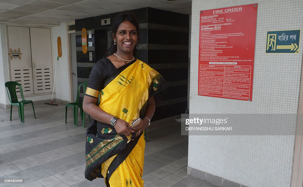 Indian transgender Riya Sarkar, the presiding officer of a polling booth, gestures as she interacts with others during voting for state assembly elections at a polling station in Kolkata on April 30, 2016. Sarkar who claims to be the first transgender in India to preside over a polling booth, is officiating at South City International School in the State Assembly constituency of Rashbehari. State assembly elections in West Bengal are taking place from April 4 to May 5. / AFP / Dibyangshu SARKAR