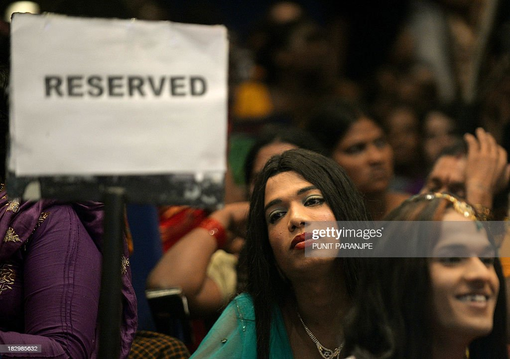 Indian transgenders attend a seminar for the transgender community in Mumbai on October 3, 2013. For India's gay community, the joy that greeted year 2009 court ruling legalising gay sex is tempered by the fact that, although the law now accepts them, society still does not. For all the celebrations and talk of an historic milestone, many believe it will take more than a court decision to change public attitudes toward homosexuality, which is largely taboo in India and considered by many to be a mental illness.