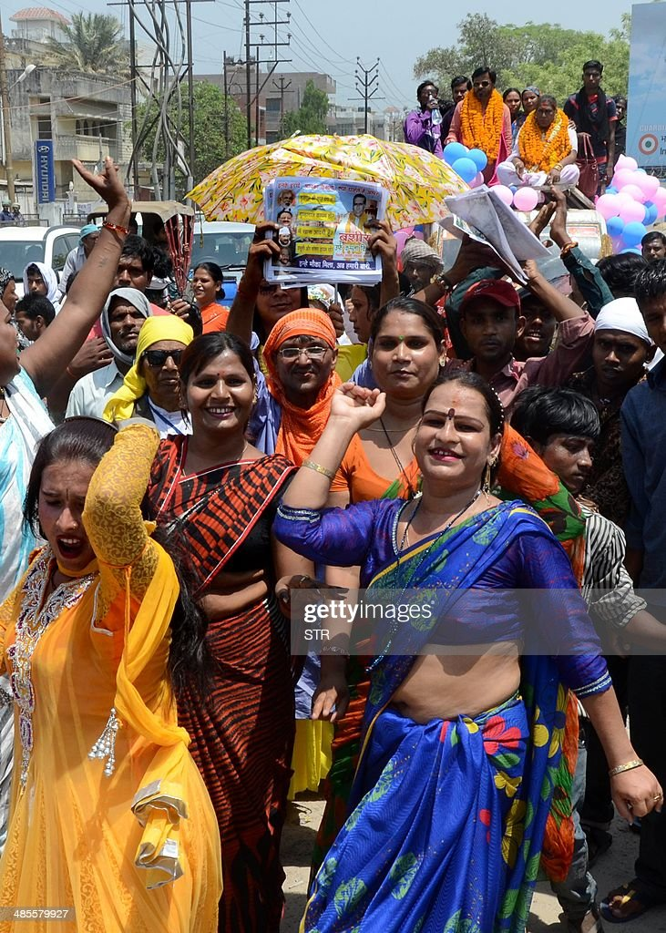 Indian transgenders dance in support of independent transgender candidate Bashir Kinnar alias 'Kamala Kinnar' on the way to file nomination papers for the Lok Sabha Elections in Varanasi on April 19, 2014. India's 814-million-strong electorate is voting in the world's biggest election which is set to sweep the Hindu nationalist opposition to power at a time of low growth, anger about corruption and warnings about religious unrest.