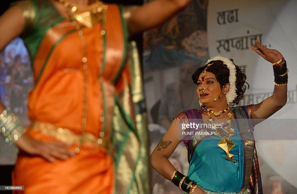 Indian transgenders perform at a seminar for the transgender community in Mumbai on October 3, 2013. For India's gay community, the joy that greeted year 2009 court ruling legalising gay sex is tempered by the fact that, although the law now accepts them, society still does not. For all the celebrations and talk of an historic milestone, many believe it will take more than a court decision to change public attitudes toward homosexuality, which is largely taboo in India and considered by many to be a mental illness.