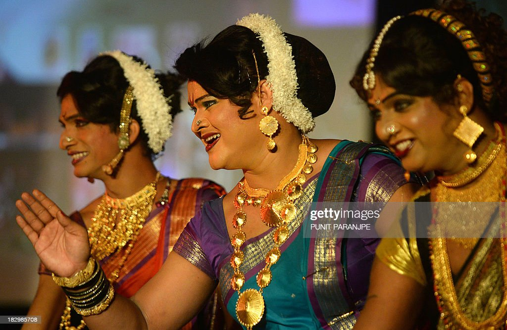 Indian transgenders perform at a seminar for the transgender community in Mumbai on October 3, 2013. For India's gay community, the joy that greeted year 2009 court ruling legalising gay sex is tempered by the fact that, although the law now accepts them, society still does not. For all the celebrations and talk of an historic milestone, many believe it will take more than a court decision to change public attitudes toward homosexuality, which is largely taboo in India and considered by many to be a mental illness. AFP PHOTO/ PUNIT PARANJPE