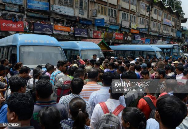 Indian travellers wait for governmentprovided buses following clashes between police and protesters supporting the Gorkha People's Liberation Front...