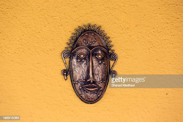 Indian tribal art: copper mask with human figures