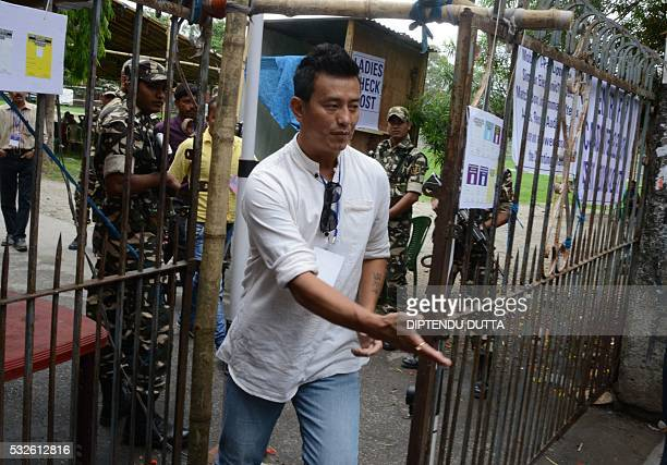 Indian Trinamool Congress party candidate for Darjeeling Constituency Baichung Bhutia leaves the counting centre after his defeat in the West Bengal...