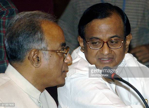 Indian Union Finance Minister P Chidambaram talks with Indian State of West Bengal's Finance Minister and chairman of the Empowered Committee on...