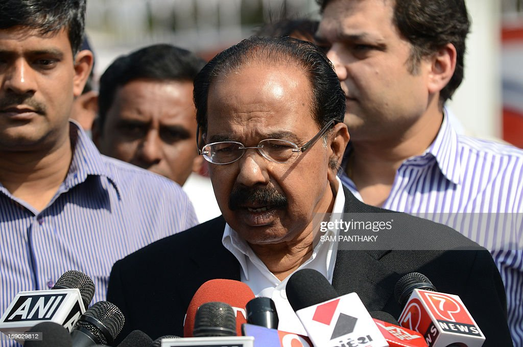 Indian Union Petroleum and Natural Gas Minister Veerappa Moily speaks to the media outside the Indian Oil Corporation (IOC) plant at Hajira near Surat, some 275 kms from Ahmedabad on January 6, 2013. Three persons were killed in a major fire in a storage tank of IOC terminal, which was contained after a 21-hour operation by fire brigade team, officials said according to the Press Trust of India (PTI). AFP PHOTO / Sam PANTHAKY