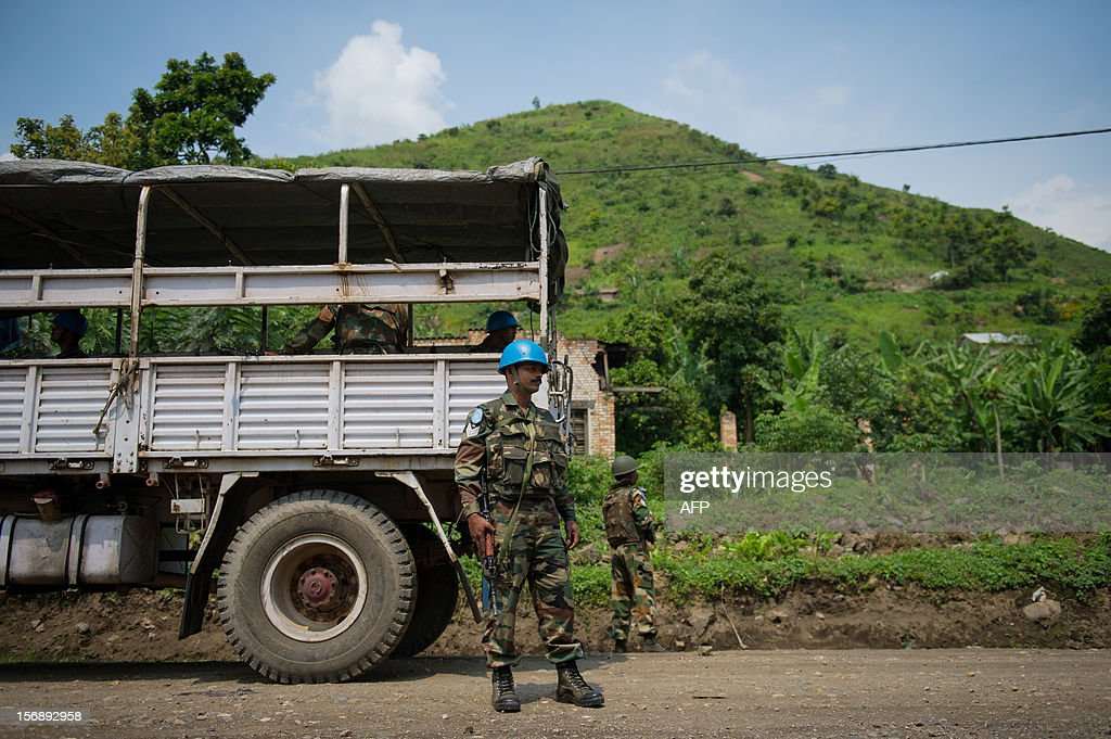 Indian United Nations peacekeepers stand on the roadside in the village of Kirotshe, 8km south of Sake in the east of the Democratic Republic of the Congo on November 24, 2012. The United Nations were patrolling the road south of Sake today before being turned back by a group of Maï-Maï militia on the road out of Shasha, around 11km south of Sake.
