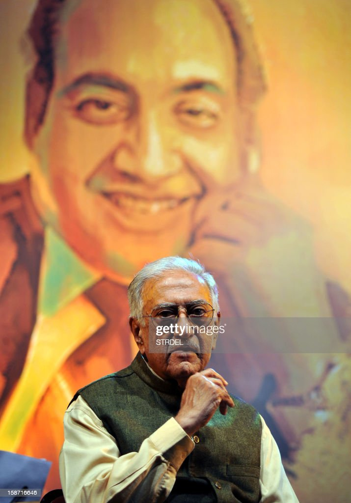 Indian veteran radio jockey Amin Sayani looks on during an event where he was conferred the Mohammed Rafi Awards ceremony in Mumbai on December 25, 2012.