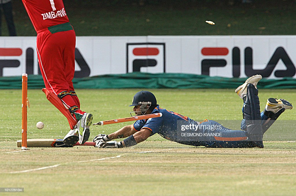 Indian Vice captain Virat Kohli (R) is run out for 13 runs by Zimbabwe's Elton Chigubura in the first match of the Micromax Cup Triangular One-Day International series on May 28, 2010 at Queens Sports club in Bulawayo. AFP PHOTO / Desmond Kwande