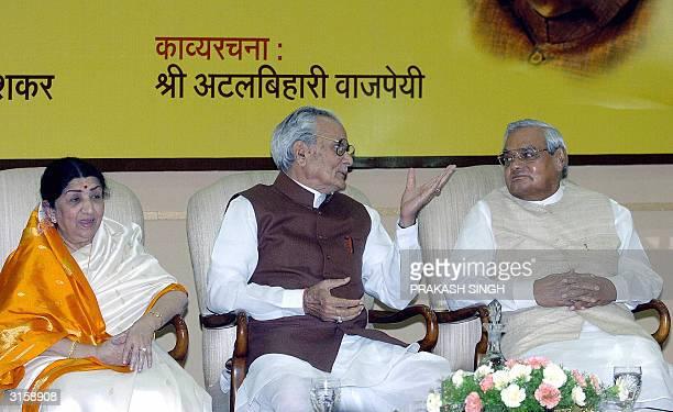 Indian Vice President Bhairon Singh Shekhawat talks to India Prime Minister Atal Behari Vajpayee as renowned Indian singer Lata Mangeshkar looks on...