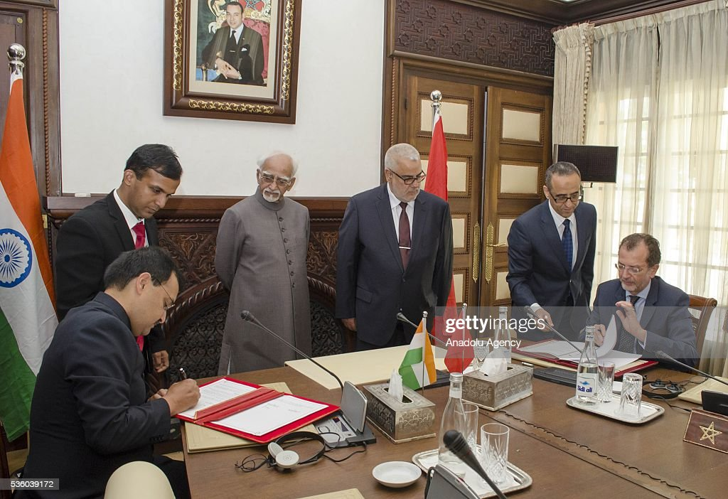 Indian Vice President Mohammad Hamid Ansari (L 3) and Moroccan Prime Minister Abdelilah Benkirane (R 3) stand as their representative sign a cooperation agreement in Rabat, Morocco on May 31, 2016.