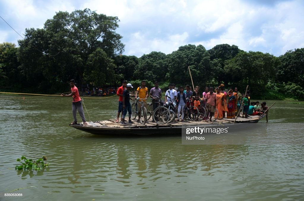 Indian villagers are on their way to the remote villages crossing the river by boat in Nadia district, 95 km from Kolkata , India on Friday , 18th August, 2017. Villagers and children risk their lives every day crossing the river in the remote areas of the districts of West Bengal .