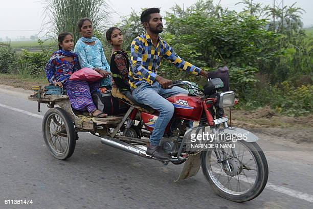 TOPSHOT Indian villagers from the IndiaPakistan border area evacuate from a border village about 35 kms from Amritsar on September 29 after the...