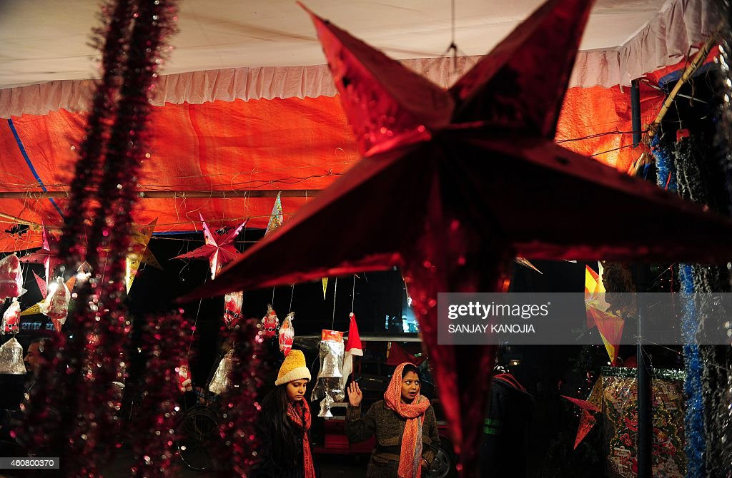 Indian visitors peruse Christmas decorations at a roadside shop ahead of Christmas Day in Allahabad on December 23 2014 Despite Christians forming a...