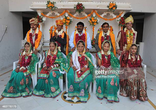 Indian visually impaired couples pose for a photograph after particpating in a mass marriage at the Andh Kanya Praksh Gruh in Ahmedabad on January 19...