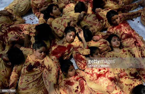 Indian volunteers for animal rights group People for the Ethical Treatment of Animal wear costumes depicting blood during a protest against leather...