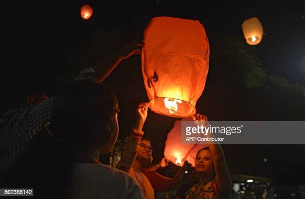 Indian volunteers of a street dog organisation release sky lanterns to promote a peaceful and ecofriendly Diwali and to create awareness to save...