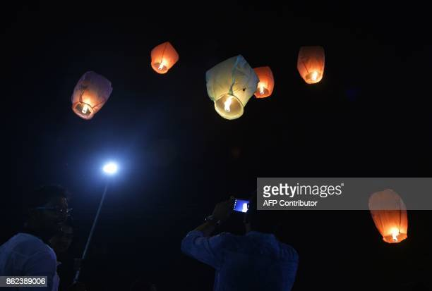Indian volunteers of a street dog organisation release sky lanterns to promote a peaceful and ecofriendly Diwali and create awareness to save street...