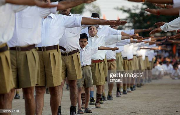 Indian volunteers of Hindu nationalist Rashtriya Swayamsevak Sangh party gather during a visit by their chief Mohan Bhagwat in Jammu on September 29...