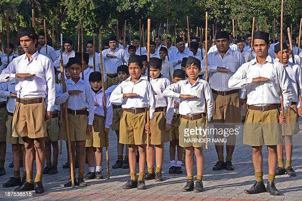 Indian volunteers of the Hindu nationalist Rashtriya Swayamsevak Sangh gather for a march to mark the foundation day of the RSS in Amritsar on...