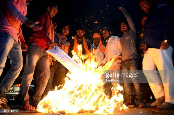 Indian volunteers of Vishwa Hindu Parishad burn the effigy of Pakistan againest the Pakistan military court's decision to hand a death sentence to...