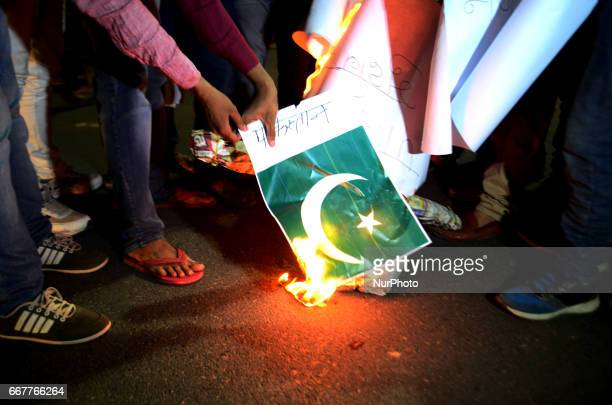 Indian volunteers of Vishwa Hindu Parishad burn the national flag of Pakistan againest the Pakistan military court's decision to hand a death...