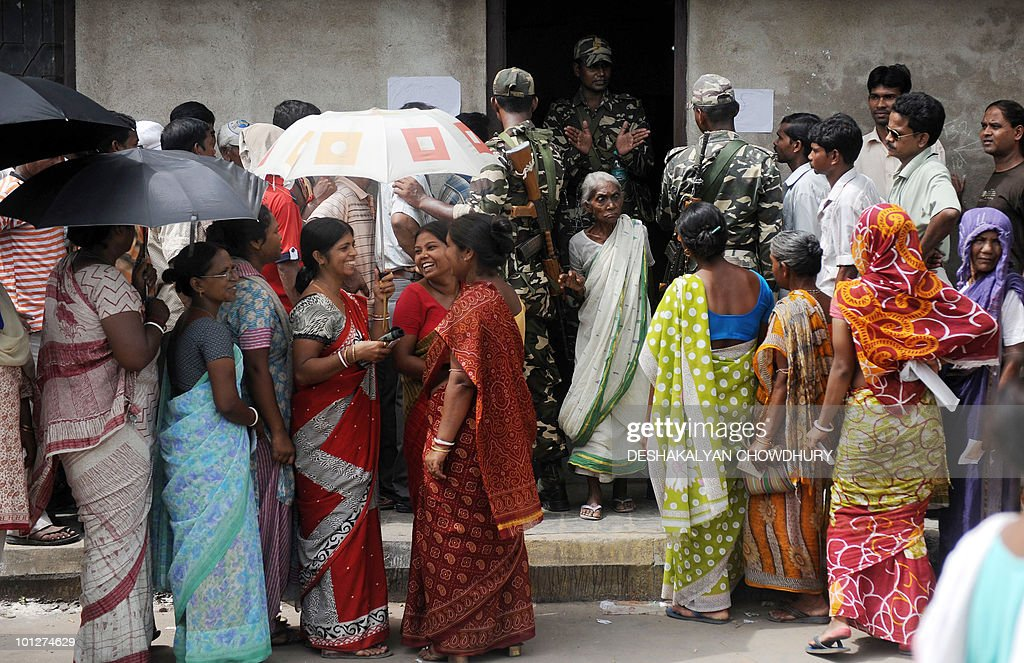 Indian voters queue outside a polling station before casting their vote in Kolkata on May 30, 2010. Polling for the crucial election to Kolkata municipal corporation and 81 civic bodies across West Bengal, seen as a 'semi-final' to 2011 assembly polls, began amidst tight security, local media reported. AFP PHOTO/Deshakalyan CHOWDHURY