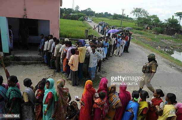 Indian voters queue outside a polling station in Thakurganj village in India's Bihar state on October 21 2010 Moderate voting was reported in the...