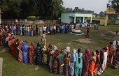 Indian voters queue to cast their ballots at a voting centre in the final stage of state assembly elections in the Bihar village of Thakurganj in...
