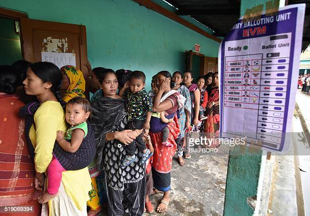 Indian voters queue to cast their ballots in the state assembly elections at a polling station in Diphu in the Karbi Anglong district some 215kms...