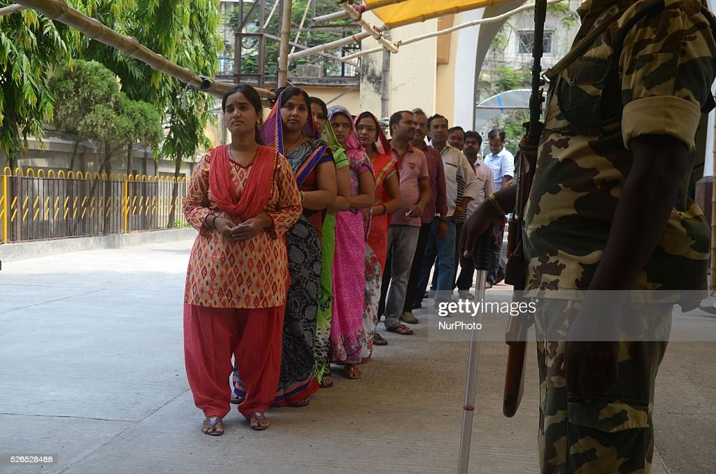 Indian voters standing in a queue at a polling station in Kolkata, India on Saturday , 30th April , 2016. The fifth phase of state assembly elections in West Bengal are taking place from April 4 to May 5, 2016.
